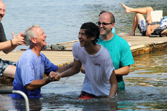 Baptist river baptism at Robius Landing by Eli Christman on flickr